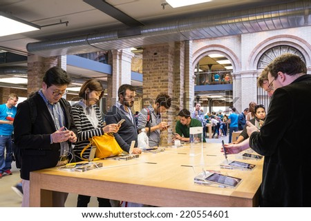 London, United Kingdom - SEPTEMBER 26, 2014: Customers admiring the new Apple iPhone 6 and iPhone 6 Plus at the Apple Inc. store on September 26, 2014 in Covent Garden in London, UK.