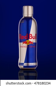 LONDON, UNITED KINGDOM-SEPTEMBER 3, 2016: Bottle of Red Bull Energy Drink. In terms of market share, Red Bull is the most popular energy drink in the world.On blue background.