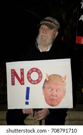 London, United Kingdon - Febuary 20th, 2017: Protesters gather in Parliament Square to protest the invitation to United States President Donald Trump on a state visit to Great Britain.