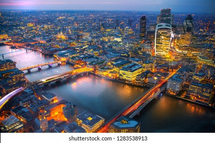 London view at sunset. Panorama include river Thames, bridges and City of London buildings.