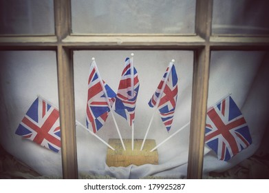 London window decorated with Union Jack Flags