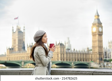 London woman drinking coffee by Westminster Bridge. Serious pensive thoughtful young female professional business woman in London, England. Beautiful young multiracial Asian Caucasian girl.