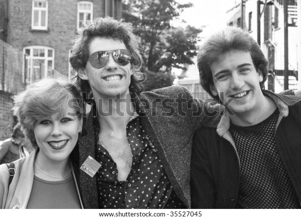 LONDON-CIRCA 1978: Bob Geldof (centre), Lead singer of Irish pop group The Boomtown Rats poses with two fans circa 1978 in London.