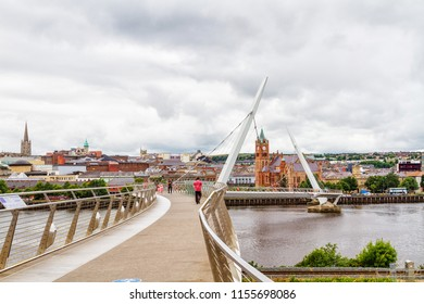"""LONDONDERRY, NORTHERN IRELAND - JULY 8, 2018: Urban skyline of Derry city (also called Londonderry) in northern Ireland with the famous """"Peace Bridge"""", Europe - Northern Ireland"""