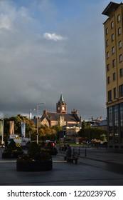 Londonderry, Northern Ireland - September 21. 2018: Londonderry city hall in straight sunshine, before heavy rain.