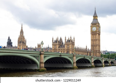 London/England - 06.03.2014: London Westminster Bridge with Houses of Parliament in background on summer day with grey clouds