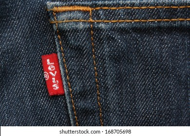 LONDON,ENGLAND  - APRIL 18 2011: Close up of the Levis red label on the back pocket of a pair of denim jeans. Levis is a brand name of Levi Strauss and Co, founded in 1853