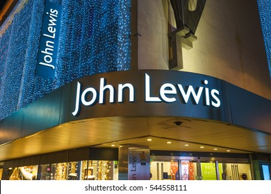 LONDON,ENGLAND - DECEMBER 16,2016: John Lewis sign at the department store exterior at Oxford street with wall of lights as part of its Christmas decorations