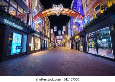 LONDON,ENGLAND - DECEMBER 16,2016:Christmas holiday signs of love, hope, kiss and wish at the shopping center of Carnaby Street