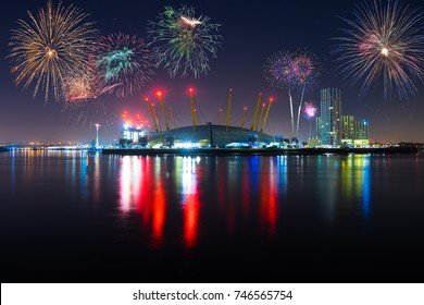 LONDON,ENGLAND - DECEMBER 31, 2015: O2 Arena with reflection and fireworks, celebration of the New Year in London, UK