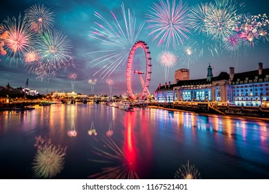 LONDON,ENGLAND - DECEMBER 31,2017: London Eye and Queen's Walk with Fireworks