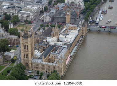 London/England - July 30 2016 Central London from the air. River Thames and Westminster Bridge next to The Palace of Westminster, Portcullis House), Parliament Square, and Westminster Abbey