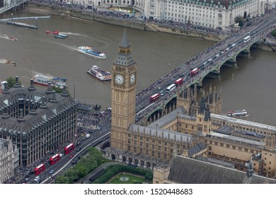 London/England - July 30 2016 Central London from the air. Ferry boats on the River Thames next to Westminster Bridge, behind The Palace of Westminster and Portcullis House.