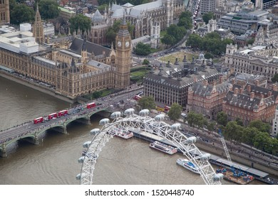 London/England - July 30 2016 Central London from the air. River Thames, Westminster Bridge,The London Eye,London Aquarium (below) and The Palace of Westminster,Portcullis House