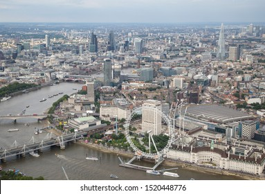 London/England - July 30 2016 Central London from the air. The London Eye infront of Waterloo Station in-between the South Bank, Hayward Gallery and the London Aquarium and Waterloo Bridge