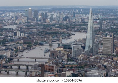 London/England - July 30 2016 Central London from the air. London cityscape, inc The Shard, Canary Wharf, 1 Canada Square, HSBC building at 8 Canada Square, Citigroup Centre buildings,and 4 bridges