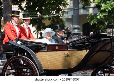 London/England - June 16, 2017: Her Royal Majesty Queen Elizabeth rides in a horse-drawn carriage during Trooping the Colour, which marks the Queen's official birthday.