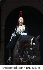 London/England - June 16 2017: A member of the Queen's guard on horseback outside of Buckingham Palace, London UK