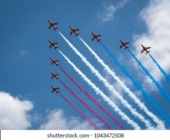 LONDON/ENGLAND - JUNE 17, 2017: RAF Red Arrow display planes leave trails of red, white and blue smoke during their flyby at Trooping the Colour, the queen's annual birthday parade.