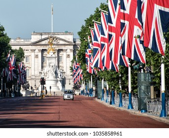 London/England - June 17, 2017 - Union Jack flags line The Mall in front of Buckingham Palace for Trooping the Colour, the Queen's official birthday celebration.