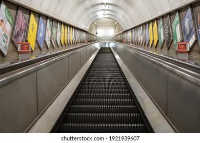 London,England,20 January 2021; underground escalator at Angel station scenery during the lockdown pandemic no passengers