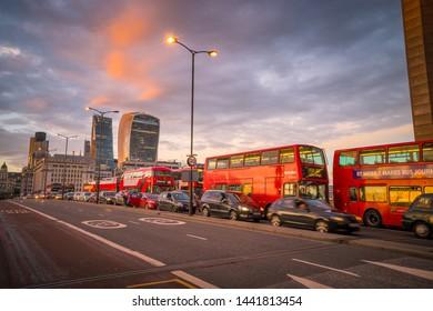 LONDON,ENGLAND-MAY 12,2017: Evening traffic at Southwark bridge