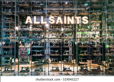 LONDON,ENGLAND-NOVEMBER 19,2016:The main window, full of old fashioned sewing machines, of the All Saints store on Westfield shop centre London.AllSaints is a British fashion retailer headquartered.