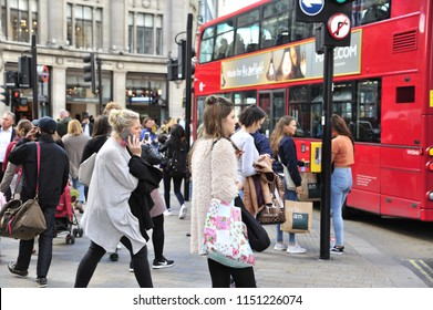 London,England/United Kingdom- 09/13/2017: Attractive young women wait to board a bus near Regent Street.