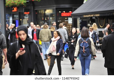 London,England/United Kingdom- 09/15/2017: A diverse group of visitors explore the area around Carnaby Street.