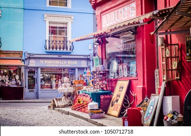 LONDON-MARCH, 2018: Colourful buildings and antique shops on London's Portobello Road, a famous shopping street and popular tourist attraction