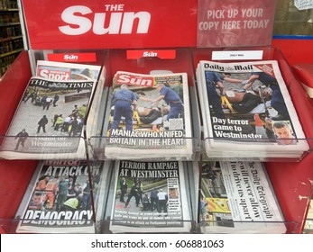 London-March 23 2017 : Local Newspapers reporting recent Westminster attack. An assailant drove a car into pedestrians and stabbing a police in front of the Parliament, leaving 5 dead and 40 injured.