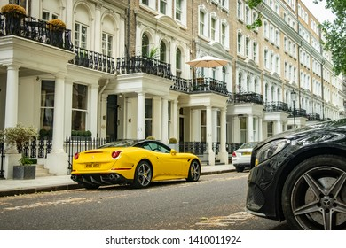 LONDON-MAY, 2019: A yellow Ferrari parked in an upmarket street of townhouses in Knightbridge.