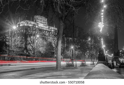 London's Embankment at night with cars passing through the street captured as light trails