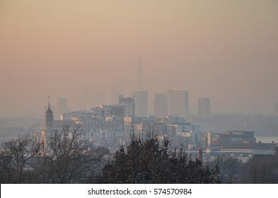 London's polluted skyline at sunset on a winter evening. London had a pollution warning between 21-24th Jan 2017.