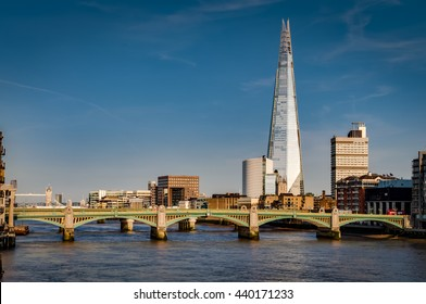 London's south bank seen from the Millennium Bridge with London Bridge, Tower Bridge and river Thames at golden hour