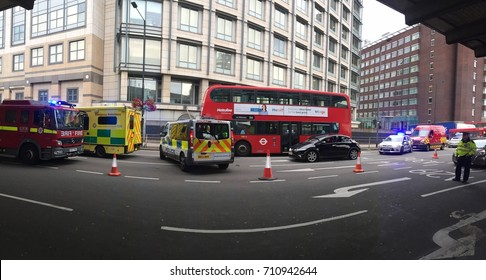London-September 2017 : Emergency response team attending a road accident underneath the Hammersmith flyover in London, UK during a rush hour involving a car and a bus.