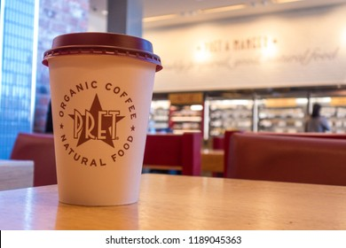 LONDON-SEPTEMBER, 2018: Pret a Manger disposable coffee cup and store interior, a British international sandwich shop chain