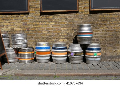 London,UK. 04.04.2016. Colorful kegs of beer at the exit of a pub, on a brick wall