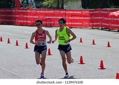 London/UK 04/22/18 Virgin Money London Marathon 2018 Para athlete SHINYA WADA (JAPAN) approaches the finish line with his guide runner