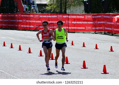 London/UK 04/22/18 Virgin Money London Marathon 2018 Para athlete SHINYA WADA (JAPAN) approaches the finish line with his guide runner