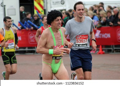 London/UK 04/26/2015 Pictured a few yards from the finish in front of Buckingham Palace a male competitor in a green mankini approaches the finish line. The runner beside him looks a little bemused.