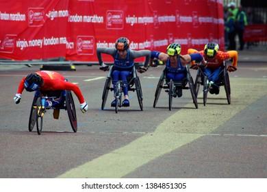 London/UK 04/28/19 Virgin Money London Marathon 2019 In the last few yards of the T53/T54 Womens wheelchair China's Lihong Zou leads Katrina Gerhard, Nikita Den Boer and Arielle Rausin