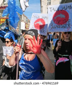 London,UK. 1 September 2016.Protesters march on the Japanese Embassy in London to mark the beginning of another season of the dolphin drive hunts in Taiji, Japan.