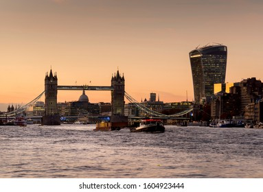 London/UK - 11.18.2019: Tower Bridge frames St Paul's Cathedral at sunset. Walkie talkie tower is on right side of frame