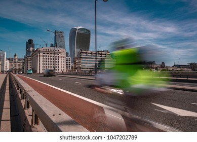 LONDON/UK - 13 AUGUST 2017: Motion of a cyclist as they speed across London Bridge towards The City on a Summers Morning