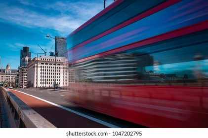 LONDON/UK - 13 AUGUST 2017: Motion of a London bus as it speeds across London Bridge towards The City on a Summers Morning