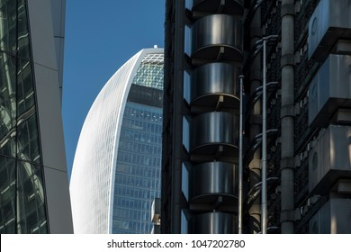 LONDON/UK - 13 AUGUST 2017: The Walkie Talkie Building seen through a gao between Lloyds of London and Willis Towers Watson on a clear summer day