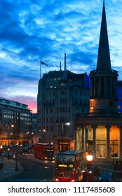 London,UK, 17th March 2018: view showing urban city with BBC office, church and London busses in the dusk sky in regent street in the picture.