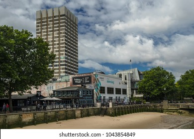 LONDON/UK - 19 AUGUST 2017: London Television Centre seen from Oxo Pier. Gabriel Wharf and a Thames River beach are in the foreground