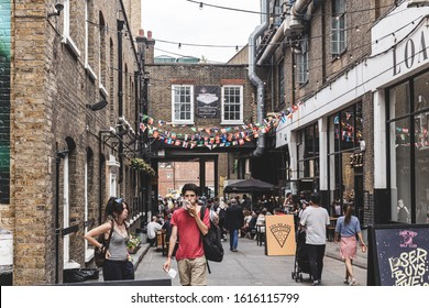 London/UK - 22/07/18: people walking at Sunday UpMarket, housed in the Old Truman Brewery's Ely's Yard on Brick Lane, that hosts many events and holds shops, bars, and restaurants